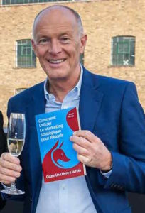 Creative industries speaker David Parrish with one of his creative industries books