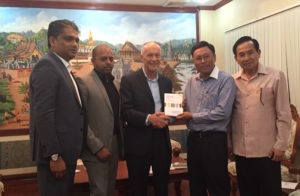 David presenting a copy of his book when discussing the creative industries in Laos (Lao PDR)